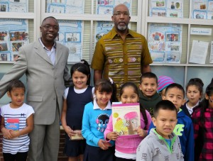 Ron Shaw and Pastor Williams with students from Verde Elementary