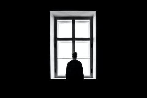 Silhouette of a person at a window
