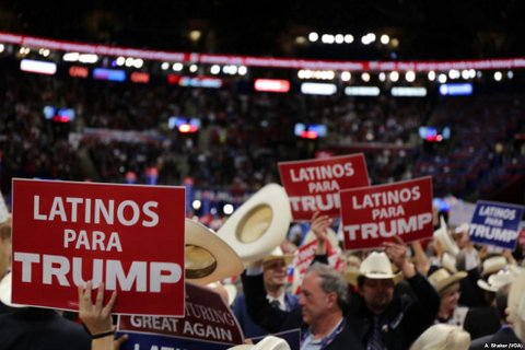 "People hold signs that read ""Latinos para Trump"" at the 2016 Republican National Convention."