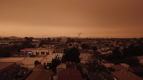 An expansive view of a Richmond neighborhood covered by an orangish- and brownish-colored sky.