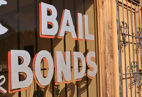 "Storefront with ""BAIL BONDS"" painted in the window"