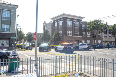 Three police SUVs in an intersection.