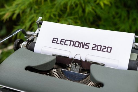 "A typewriter with the top of a piece of paper showing that says ""ELECTIONS 2020."""