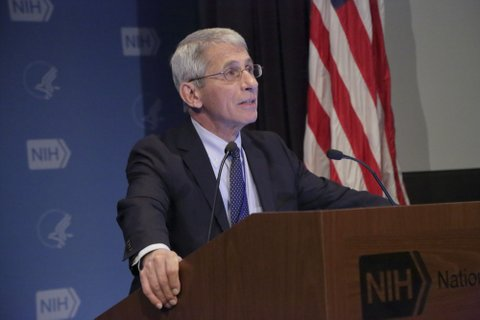 Dr. Anthony Fauci at a lectern.