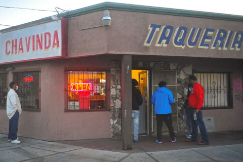 Exterior of Taqueria Chavinda with four men outside
