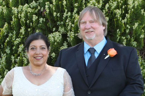 Indian woman in white wedding dress and white man in suit
