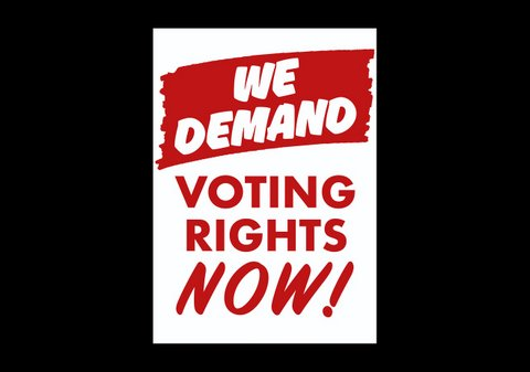 "Sign that says ""We demand"" in white text on a red background and ""voting rights now"" in red text on a white background."