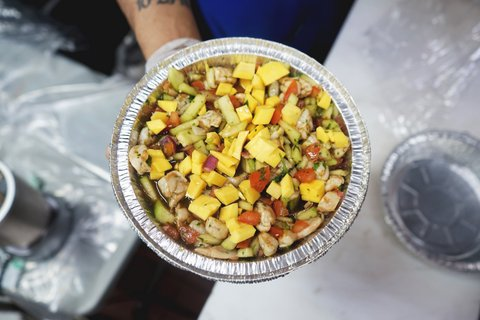 Plate of ceviche with lots of visible mango