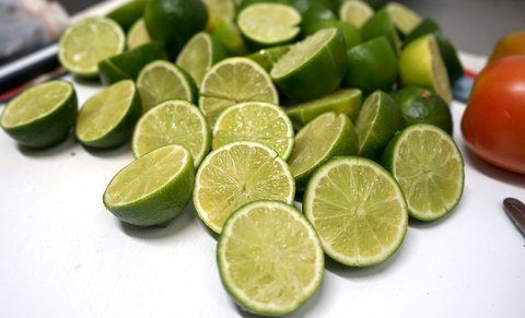 Several limes, cut in half
