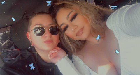 Selfie of two young women with images of blue butterflies overlaid