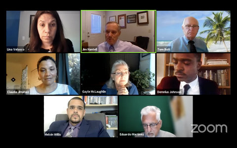 Eight people on Zoom screen in virtual meeting