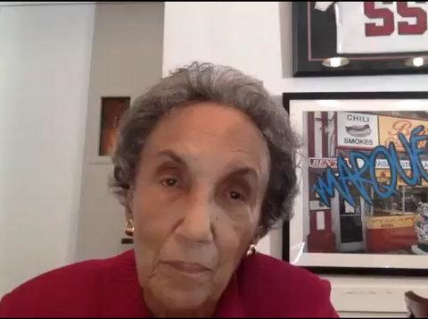 An older light-skinned Black woman with short, gray hair