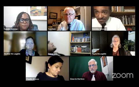 Eight people on Zoom in a virtual meeting