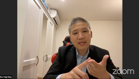 Asian man in a suit on Zoom