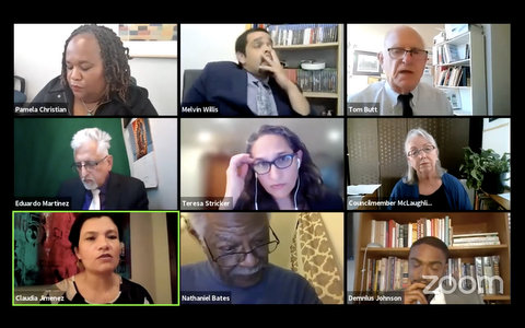 Nine people, many with exasperated expressions, in a virtual meeting