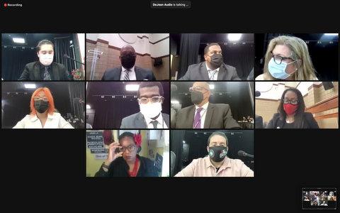 Ten people, nine wearing masks, in virtual meeting