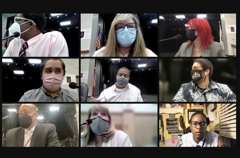 Nine people in virtual meeting, eight wearing masks